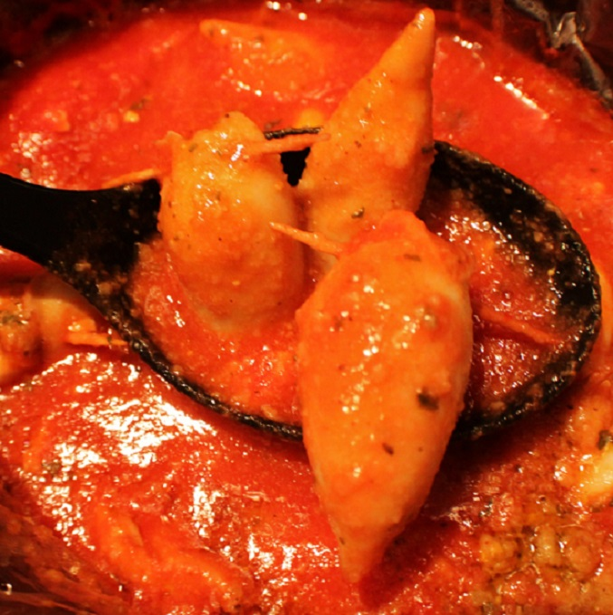 this is how to make one of the 7 fish on Christmas Eve Stuffed Calamari. This calamari is in a rich tomato sauce that has a stuffing inside and the squid is held together with toothpicks  and is an Italian tradition on Christmas Eve
