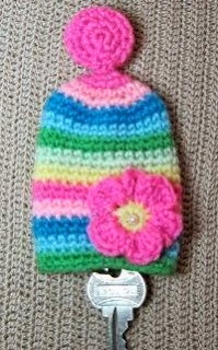 http://www.craftsy.com/pattern/crocheting/other/flower-key-cozy-crochet/20558
