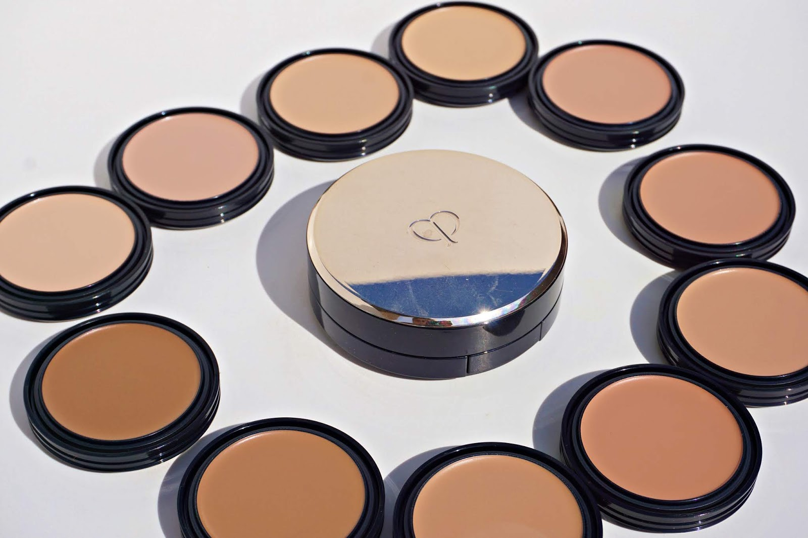cle de peau radiant cream to powder foundation swatches