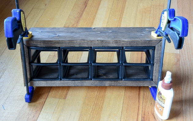 Glue and attach wood frame to plastic storage drawers