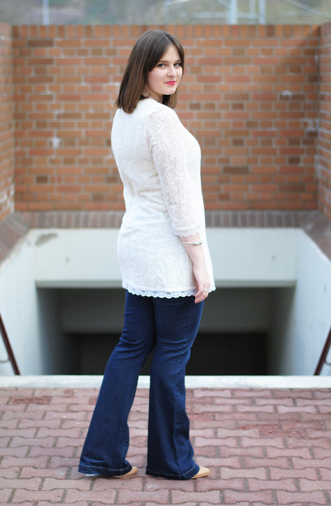 lace dress on flared jeans outfit