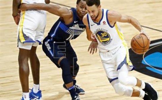Curry sella con triple triunfo de Warriors ante Mavericks