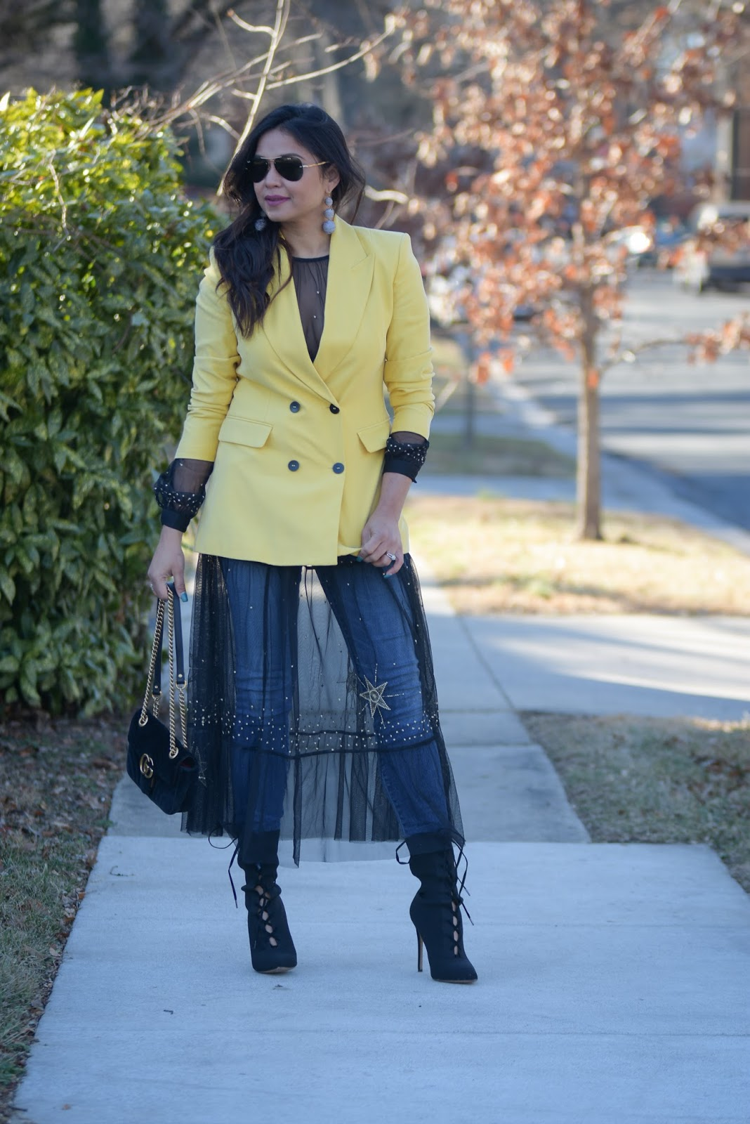 how to wear dress over jeans, mesh dress, yellow double breasted blazer, black booties, street chic, street style, black HM dress, zara blazer, ootd, myriad musings
