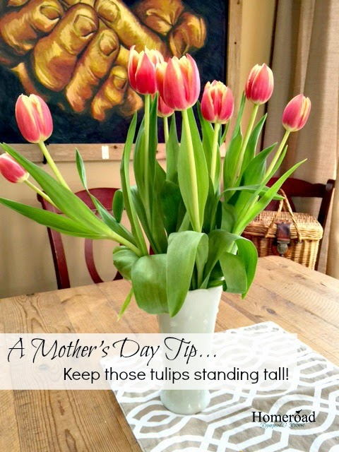 tulips in a white vase with a pinterest overlay