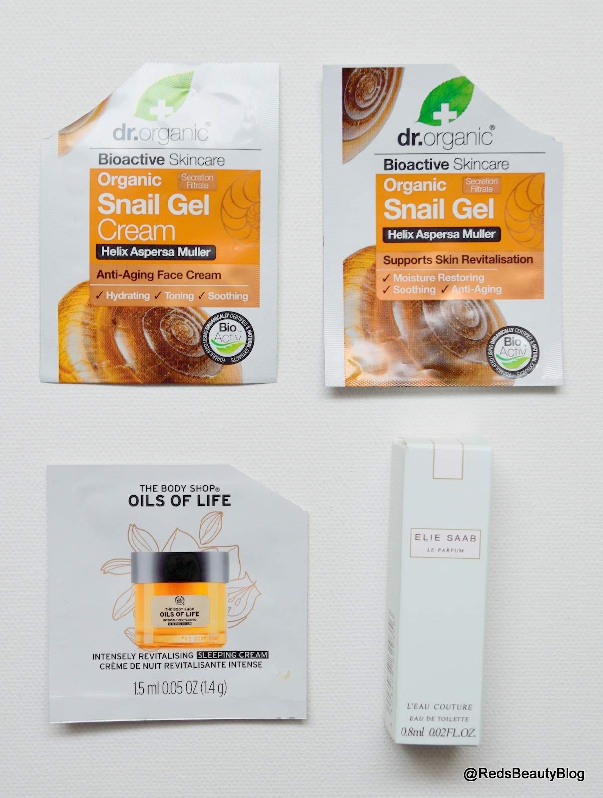 Picture of Dr Organic Snail Gel, The Body Shop Oils of Life Sleeping Cream and Elie Saab Le Parfum