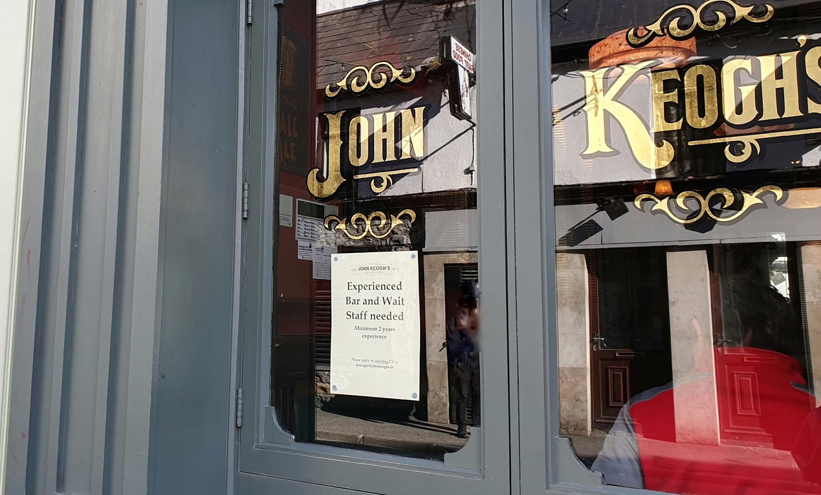 john keogh pub name in golden old-time lettering on a pub window
