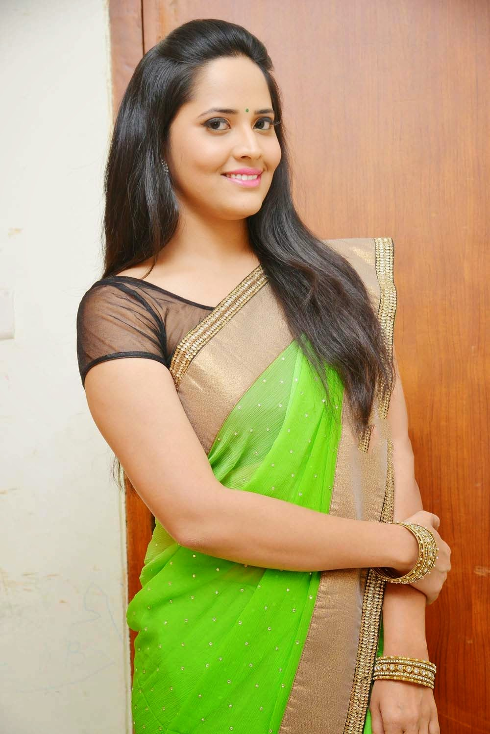 Glamorous Photos Of Anchor Anasuya In Green Saree