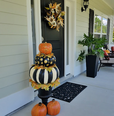 painted pumpkin topiary and solar pumpkins