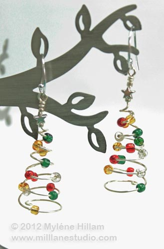 Spiral Christmas Tree earrings studded with colourful seed beads.