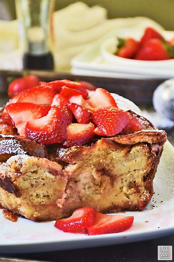 Slow Cooker French Toast sliced showing the creamy center with strawberries on top