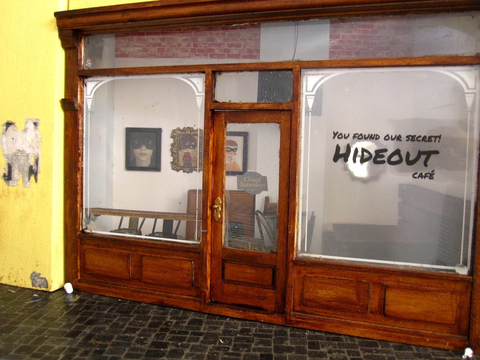 Modern dolls' house miniature cafe exterior.