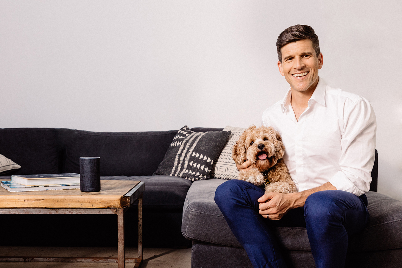Osher Günsberg and his dog Frankie sit listening to an Audible for Dogs audiobook