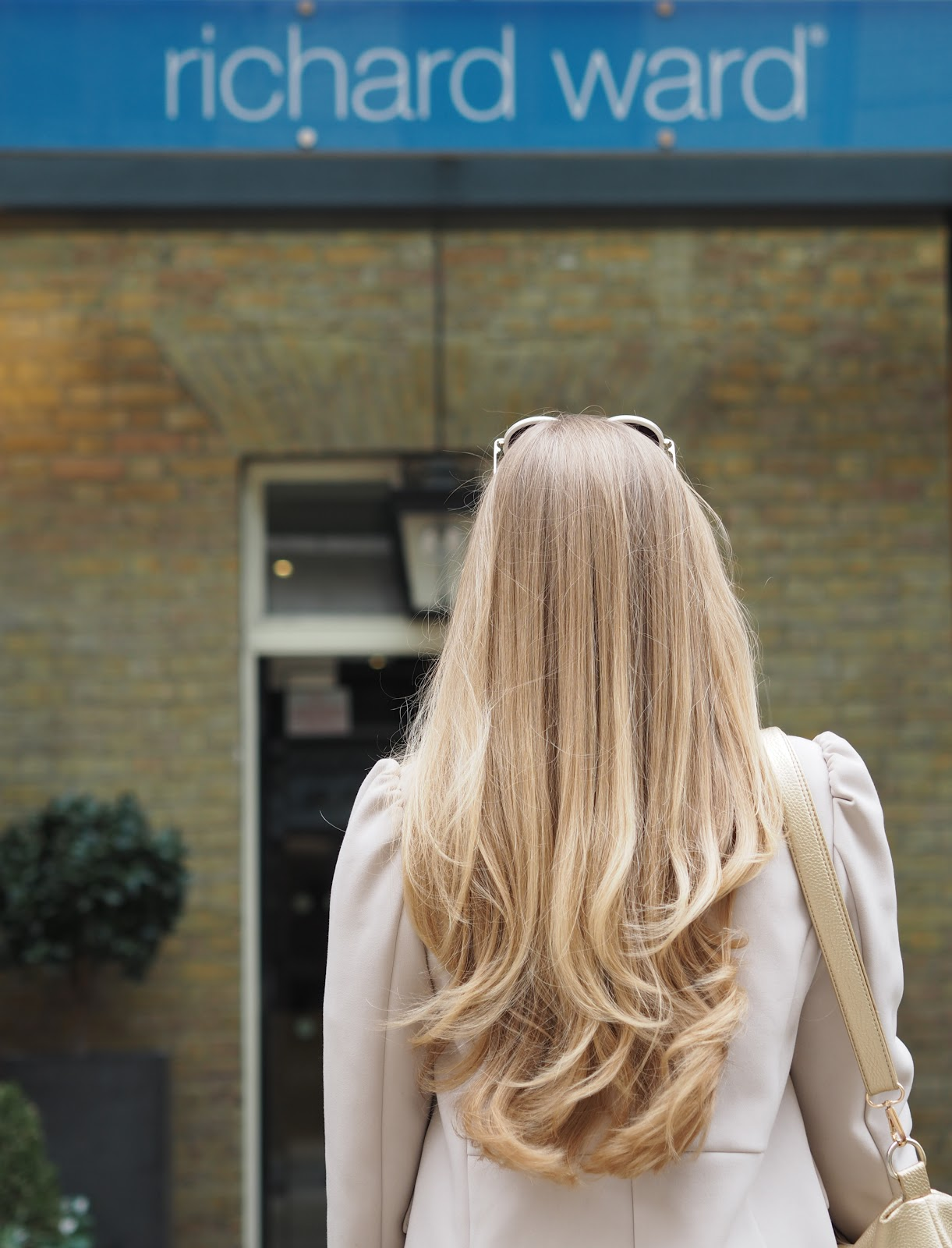 Blonde girl with a fresh blow dry outside the Richard Ward Salon, Chelsea, London