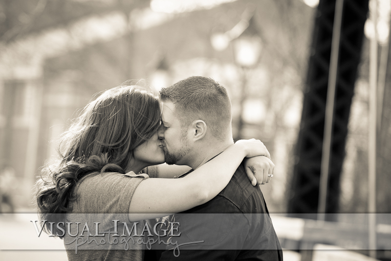 black and white photo of couple kissing in downtown Cedarburg