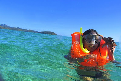 Girl Travel in Malcapuya Island