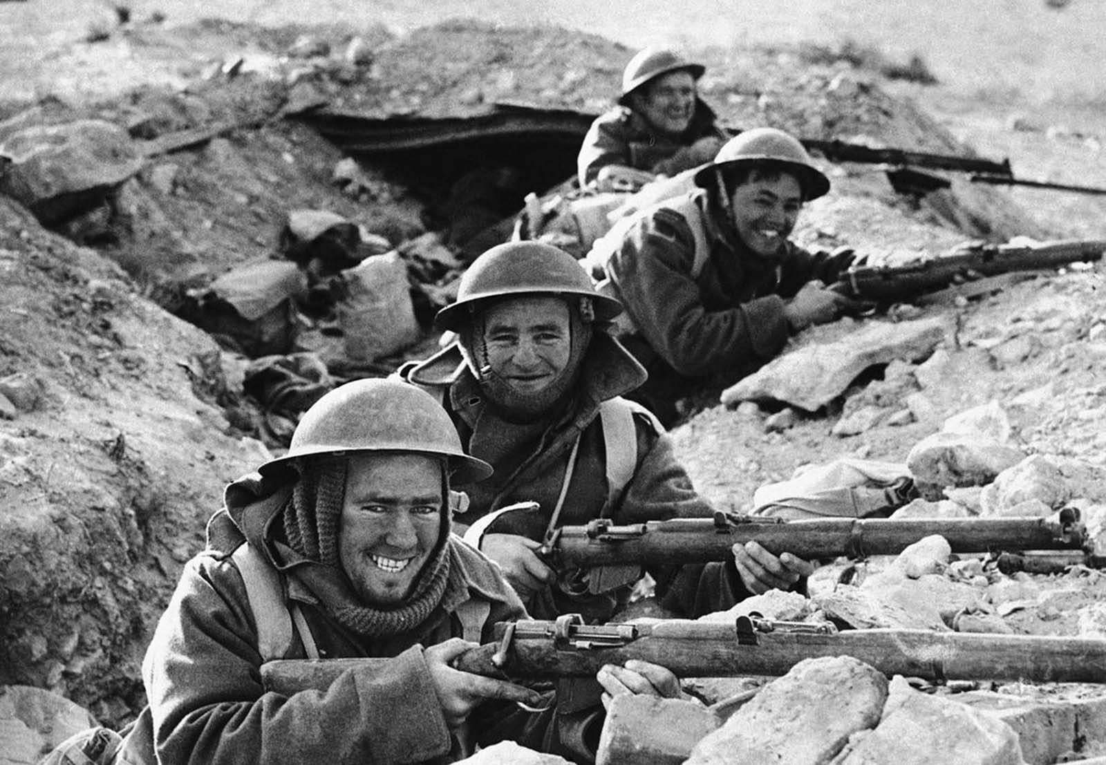 British Infantrymen in position in a shallow trench near Bardia, a Libyan Port, which had been occupied by Italian forces, and fell to the Allies on January 5, 1941, after a 20-day siege.