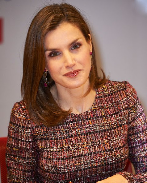 Queen Letizia wore Coolook Design Nereida Earrings, Acosta Clutch, Lodi Suede shoes, Mango, Uterque bi-color wool sweater