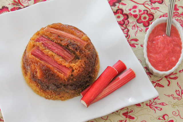 Food Lust People Love: This fresh rhubarb steamed sponge pudding is a light springtime recipe, highlighting the gorgeous pink tart rhubarb that is available now. This sticky dessert takes a while to cook but it's mostly hands off time. Wait to you bite into its soft sponge with tart topping! Totally worth the effort. The glossy pink rhubarb on top of this steamed pudding is a welcome bit of color on a dreary cold day.