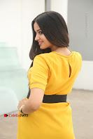 Actress Poojitha Stills in Yellow Short Dress at Darshakudu Movie Teaser Launch .COM 0304.JPG