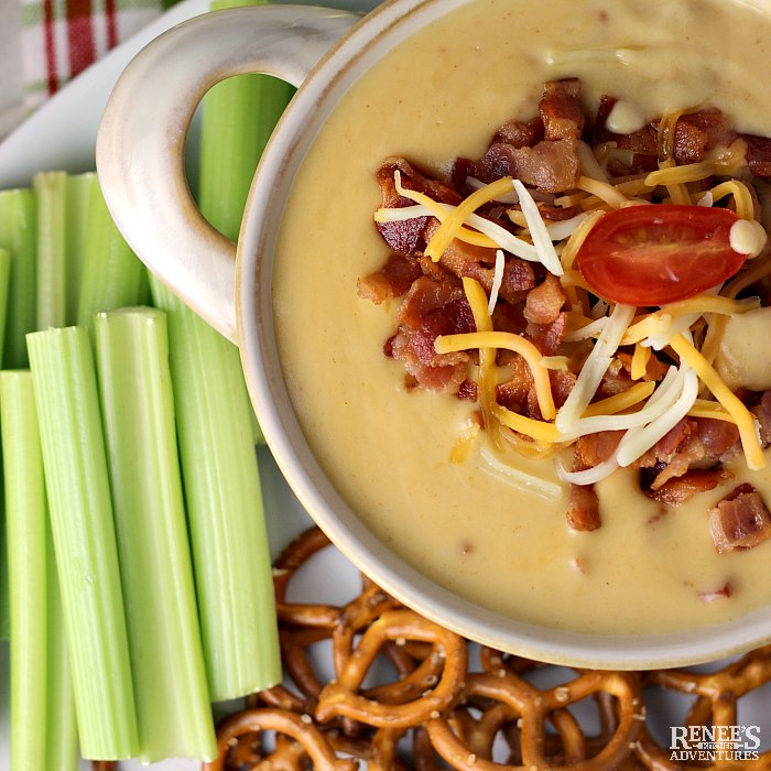 Overhead image of Beer Cheese Dip with Bacon with pretzels and celery sticks
