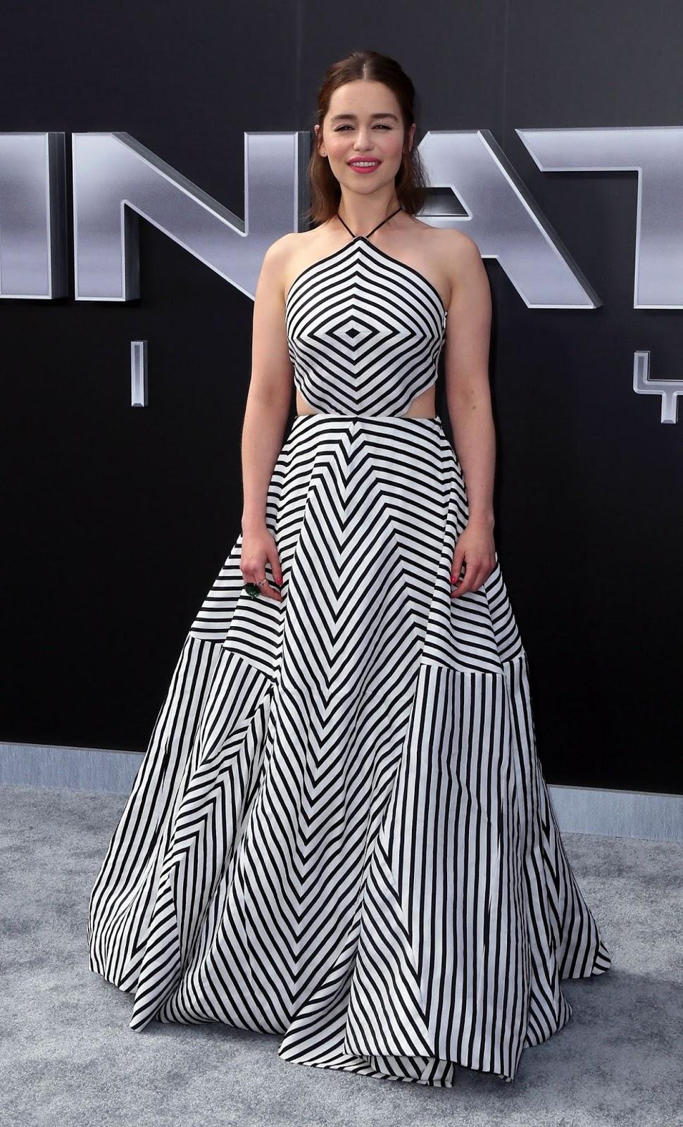 Emilia Clarke shows skin in a striped dress at the ...