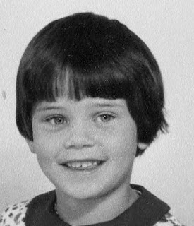 Girl aged around six in the 1960s with short dark hair