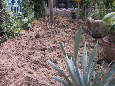 Add organic material, such as compost, manure, or shredded leaves to sandy soil to improve its ability to hold water and to clay soil to help it drain more quickly.