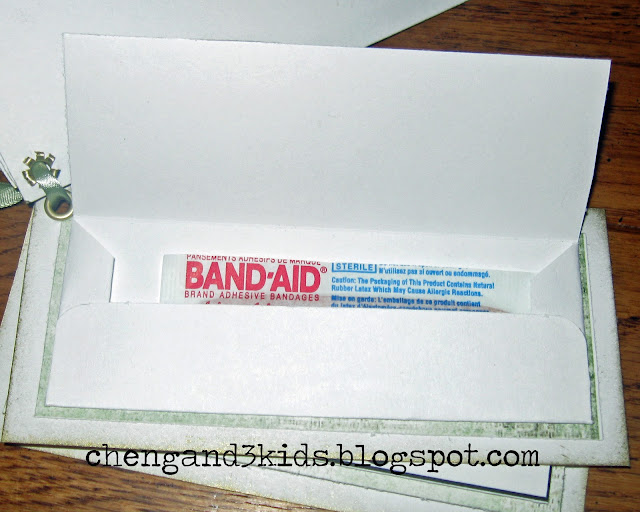 A handmade gift for Father's Day or for a dad's birthday. This page has a band-aid inside the flap.