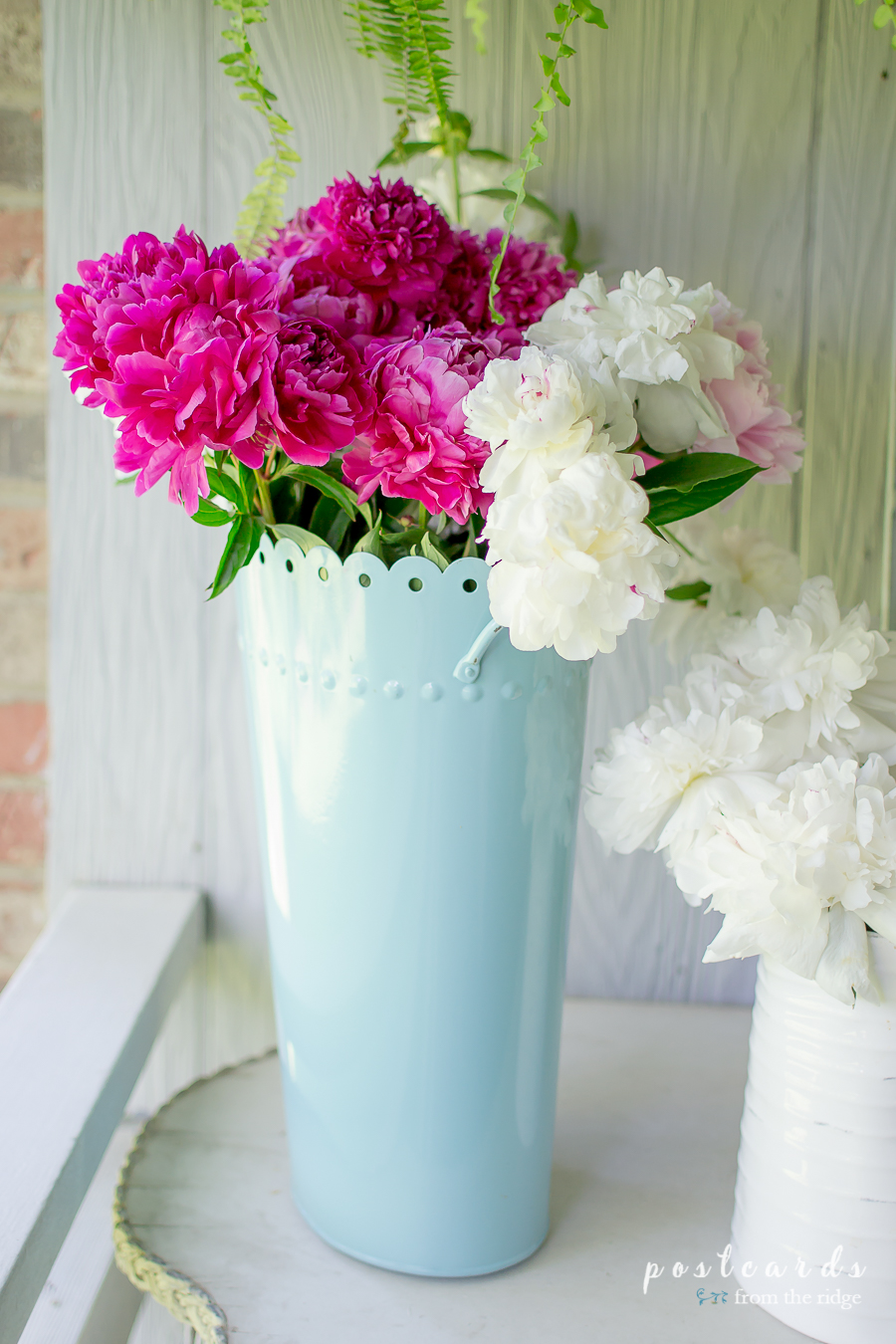 peonies in a metal flower vase