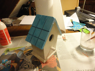 Wooden birdhouse with coat of gesso and blue roof