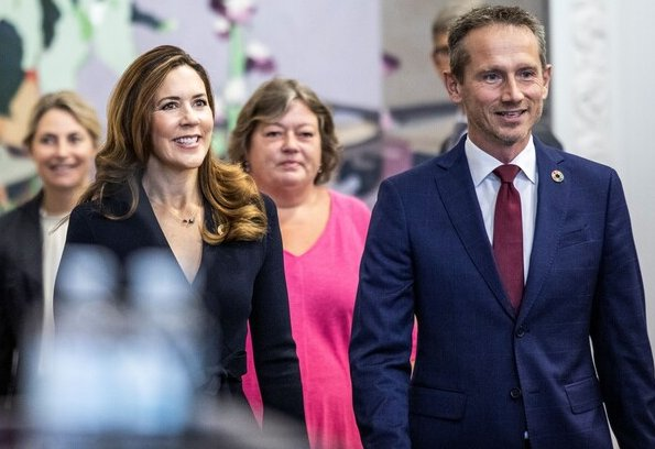 Scanlan Theodore crepe Knit wrap jacket and wide-leg trousers. Crown Princess Mary wore a crepe knit wrap jacket from Scanlan Theodore