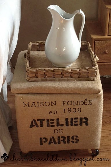 French-inspired burlap covered rolling otttoman