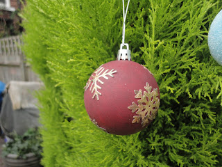 Claret coloured bauble with gold metallic snowflakes