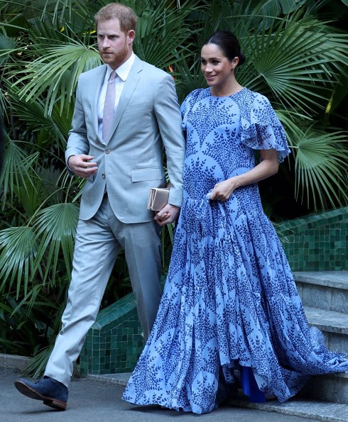 Meghan Markle wore Carolina Herrera floral printed silk chiffon short sleeve gown, and she carries Dior Bee embellished clutch