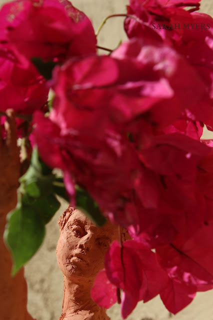 sculpture, terracotta, kneeling, woman, sarah, myers, red, clay, dance, figure, arte, escultura, figurative, classic, human, lady, poise, earthenware, orange, flowers, bougainvillea, detail, close-up, macro, face, head, nose, eyes, small