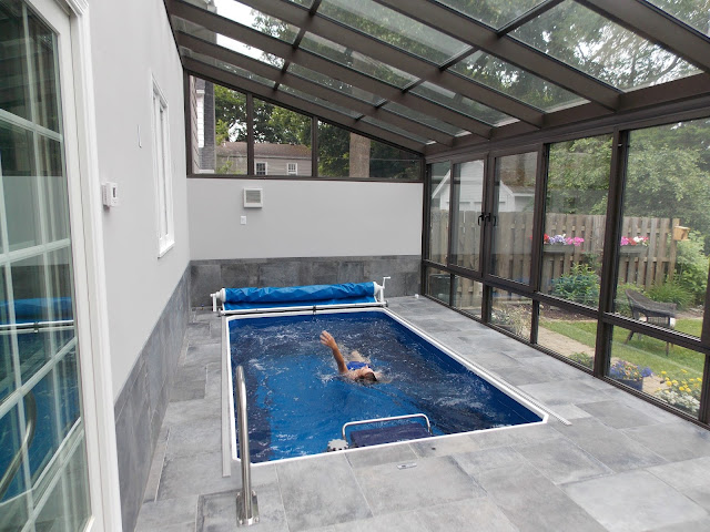 A fully in-ground Original Endless Pools swimming machine in a Rochester, NY, home addition