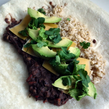 giant burrito with refried black beans, brown rice, avocado, cheddar, cilantro