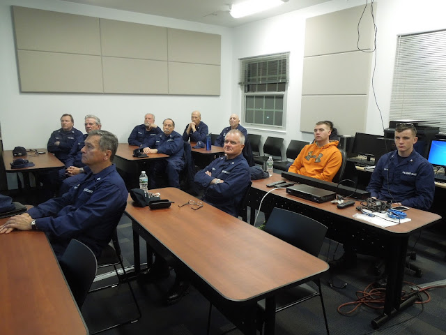 Flotilla members and active duty personnel listen attentively