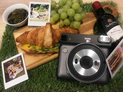 Flatlay of Instax SQ 6 Square with food