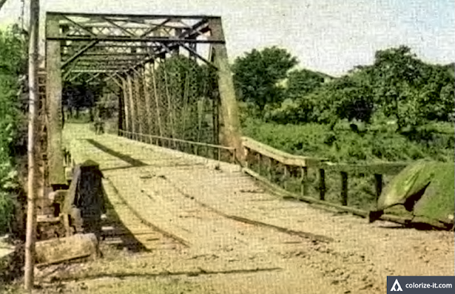 "A photo of the Palico Bridge in Nasugbu soon after the landing of troops at the beaches in 1945.  Image source:  ""The Angels:  History of the 11th Airborne Division 1943-1946."""