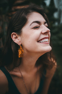 A close up of a woman smiling