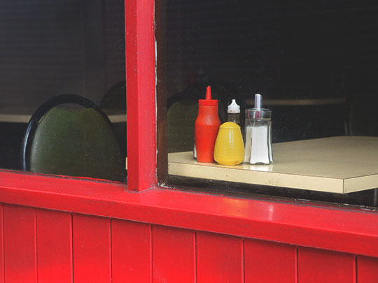 red sauce green chairs, contemporary photography, art, cafe scene, Sam Freek,