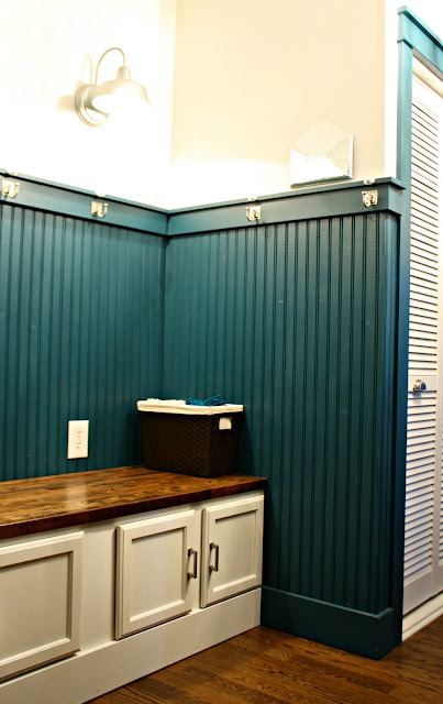 dark beadboard walls mudroom