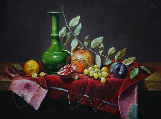 Green vase and fruits