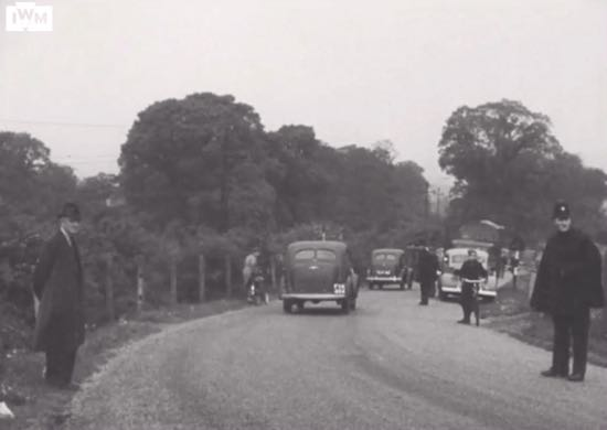 "The group leaving Brookmans Park by car along Station Road on 21 May, 1942 Image at 4'45"" in video below Screen grab courtesy of the Imperial War Museum"