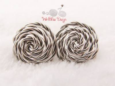 Front view of the wire wrapped rose studs by WireBliss with stainless steel wire