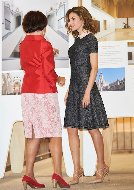Queen Letizia attends opening of the exhibition the Recognizing the Spanish Heritage in Europe at the COAM in Madrid. Queen letizia wears Magrit shoes, Felipe Varela dress and clutch bag