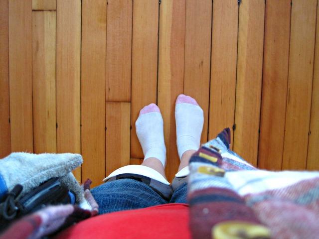 hardwood floor feet in socks knee pads