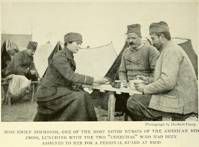 Miss Emily Simmonds, one of the most noted nurses of the American Red cross, at lunch with 2 soldiers assigned to protect her. Location – village Brod, Macedonia