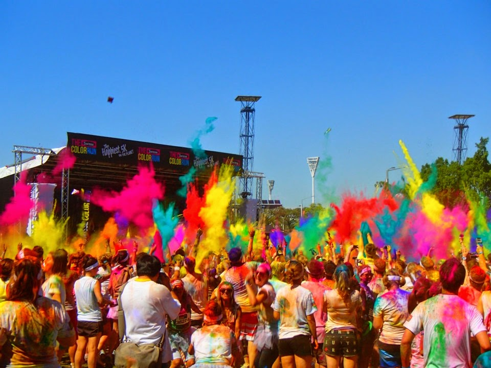 all the colours flying into the air above everyone